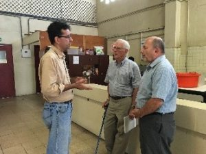 Bob (middle) talks with the school director, Eric Garcia (left) about life in Panama.